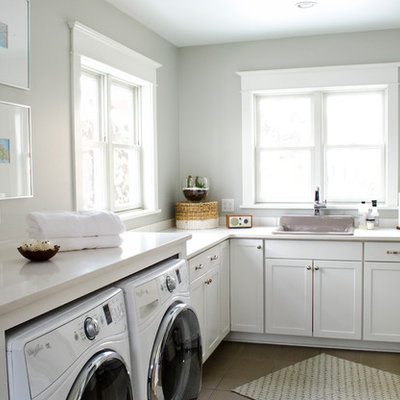 Example of a mid-sized classic l-shaped ceramic tile laundry room design in Other with a drop-in sink, shaker cabinets, white cabinets, gray walls, a side-by-side washer/dryer and white countertops