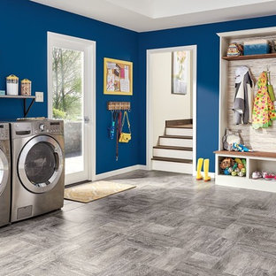 Inspiration for a large modern l-shaped utility room in Vancouver with a side by side washer and dryer, blue walls, vinyl flooring and grey floors.