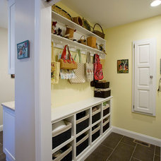 Eclectic Laundry Room by Divine Kitchens LLC