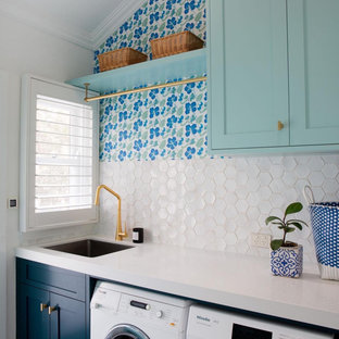 This is an example of a beach style laundry room in Other.