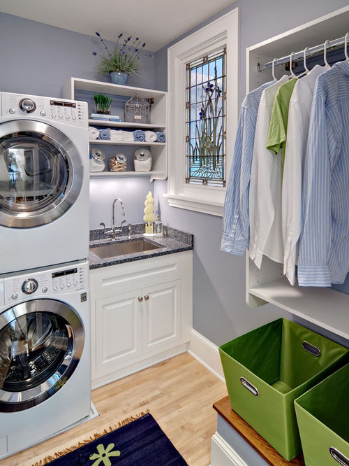 Example Of A Small Classic L Shaped Light Wood Floor And Beige Floor  Dedicated Laundry
