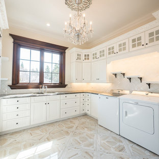 Design ideas for a large victorian u-shaped utility room in Edmonton with a submerged sink, recessed-panel cabinets, white cabinets, marble worktops, porcelain flooring, white floors and white worktops.