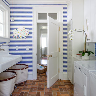 Inspiration for a timeless galley multicolored floor and brick floor dedicated laundry room remodel in Jacksonville with shaker cabinets, white cabinets, multicolored walls, a side-by-side washer/dryer, granite countertops, a farmhouse sink and white countertops