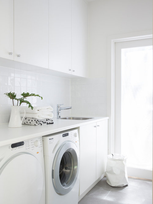 laundry room furniture. this is an example of a contemporary singlewall dedicated laundry room in sydney with furniture