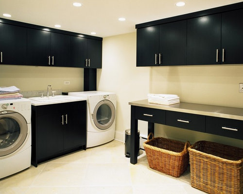 Inspiration For A Contemporary Laundry Room Remodel In Chicago With Black Cabinets And Beige Floors