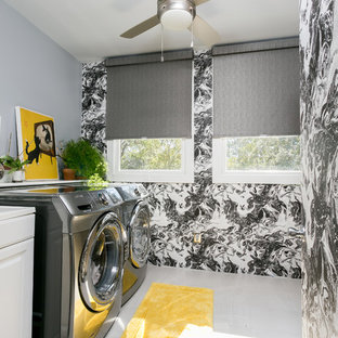 Example of a transitional single-wall laundry room design in Charleston with raised-panel cabinets, white cabinets, multicolored walls and a side-by-side washer/dryer