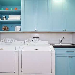 Example of a coastal laundry room design in San Francisco with white walls