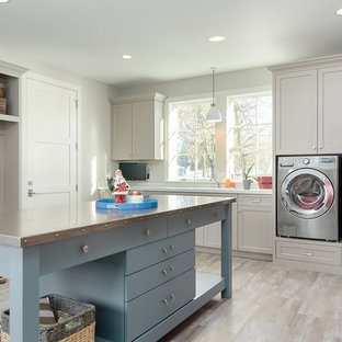 Large nautical utility room in Minneapolis with engineered stone countertops, grey walls, laminate floors, a side by side washer and dryer, shaker cabinets, grey cabinets, grey floors and white worktops.