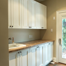 Traditional Laundry Room by Belaire Custom Cabinetry