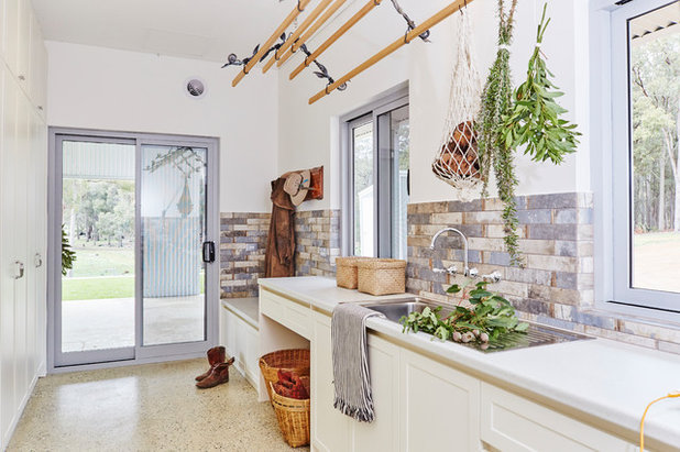 Transitional Laundry Room by Sophine Pfuhl Architect