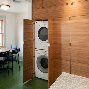 Contemporary utility room in San Francisco with lino flooring and a stacked washer and dryer.