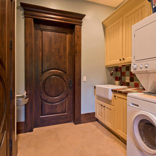 Example of a tuscan beige floor laundry room design in Salt Lake City with a farmhouse sink
