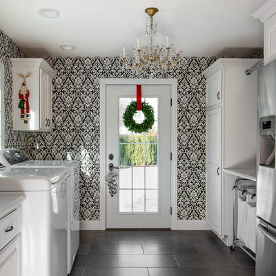 Mid-sized transitional u-shaped gray floor and ceramic tile utility room photo in Detroit with white cabinets, white countertops, raised-panel cabinets, quartz countertops, multicolored walls and a side-by-side washer/dryer