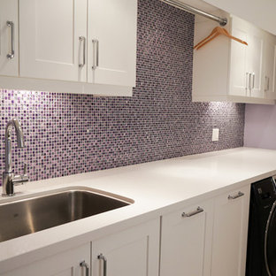Example of a mid-sized trendy galley laundry room design in Toronto with an undermount sink, shaker cabinets, white cabinets, quartz countertops, purple walls and a side-by-side washer/dryer