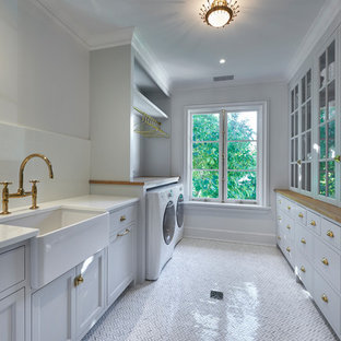 Inspiration for a transitional marble floor laundry room remodel in New York with glass countertops