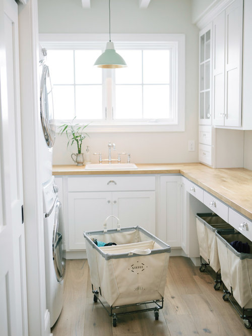 Traditional U Shaped Dedicated Laundry Room In Boston With A Drop In Sink,