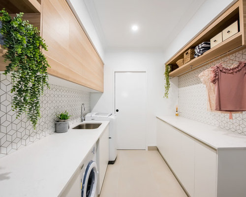 Inspiration For A Contemporary Galley Laundry Room In Brisbane With An  Undermount Sink, Flat