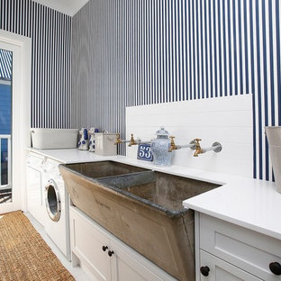 Small country single-wall dedicated laundry room in Other with a farmhouse sink, shaker cabinets, white cabinets, multi-coloured walls, ceramic floors, a side-by-side washer and dryer, white floor and white benchtop.