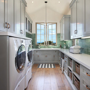 Inspiration for a mediterranean laundry room remodel in Orange County