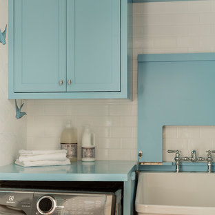 Dedicated laundry room - small transitional single-wall medium tone wood floor and brown floor dedicated laundry room idea in Boston with an utility sink, shaker cabinets, blue cabinets, wood countertops, white walls, a side-by-side washer/dryer and blue countertops