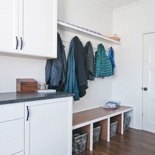 Design ideas for a large traditional galley separated utility room in Nashville with a submerged sink, recessed-panel cabinets, white cabinets, granite worktops, white walls, medium hardwood flooring, a side by side washer and dryer, brown floors and black worktops.
