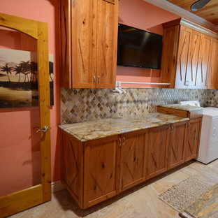 Large mountain style galley porcelain floor and beige floor utility room photo in Orange County with an undermount sink, recessed-panel cabinets, dark wood cabinets, granite countertops, pink walls, a side-by-side washer/dryer and multicolored countertops