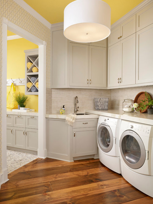Example Of A Transitional Medium Tone Wood Floor Laundry Room Design In Houston With Shaker Cabinets