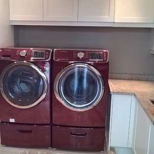 This is an example of a large classic l-shaped separated utility room in Toronto with a submerged sink, shaker cabinets, white cabinets, granite worktops, grey walls, porcelain flooring, a side by side washer and dryer, beige floors and multicoloured worktops.