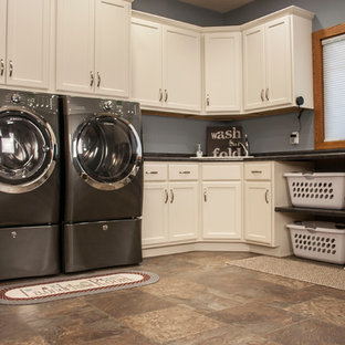 Design ideas for a large traditional l-shaped separated utility room in Other with shaker cabinets, white cabinets, vinyl flooring, a side by side washer and dryer, multi-coloured floors and black worktops.