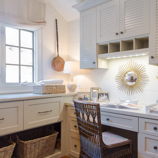 Example of a classic laundry room design in Atlanta with recessed-panel cabinets and white cabinets
