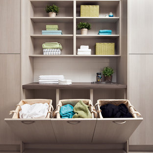 Photo of a large contemporary utility room in Toronto with flat-panel cabinets, light wood cabinets, laminate countertops, beige walls and brown worktops.