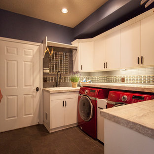 Photo of a large bohemian galley separated utility room in Portland with flat-panel cabinets, white cabinets, purple walls, ceramic flooring and a side by side washer and dryer.