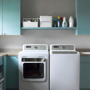 Transitional dedicated laundry room photo in Minneapolis with flat-panel cabinets, blue cabinets, a drop-in sink, a side-by-side washer/dryer, laminate countertops and beige countertops