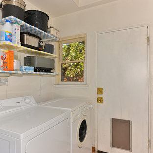 Inspiration for a small mediterranean dedicated laundry room remodel in San Diego with white walls and a side-by-side washer/dryer