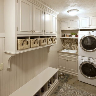 Example of a small trendy l-shaped porcelain floor and beige floor utility room design in DC Metro with a drop-in sink, beaded inset cabinets, white cabinets, quartz countertops, beige walls and a stacked washer/dryer