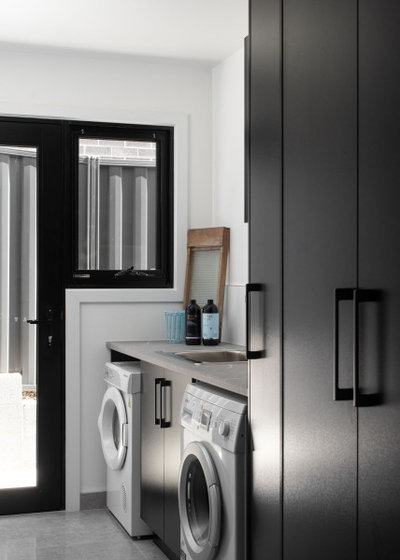Contemporary Laundry Room by Kitchen Centre