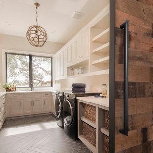 Laundry room - coastal laundry room idea in Austin