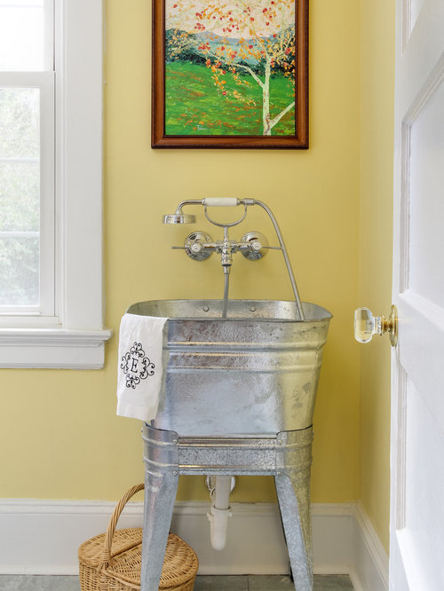 Delightful Example Of A Transitional Laundry Room Design In Raleigh With An Utility  Sink And Yellow Walls