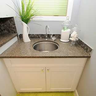Photo of a medium sized traditional single-wall utility room in Edmonton with a submerged sink, shaker cabinets, white cabinets, terrazzo worktops, grey walls, a side by side washer and dryer, porcelain flooring and beige floors.