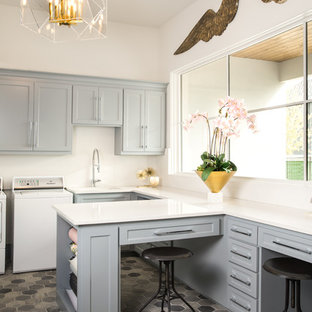 Trendy u-shaped multicolored floor dedicated laundry room photo in Dallas with an undermount sink, shaker cabinets, gray cabinets, white walls, a side-by-side washer/dryer and white countertops