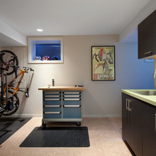 Inspiration for a contemporary laundry room in Vancouver with an undermount sink, flat-panel cabinets, dark wood cabinets, beige walls, cork floors and a stacked washer and dryer.