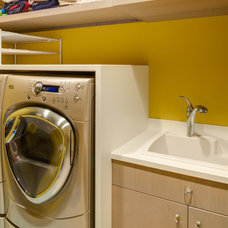 Contemporary Laundry Room by Bay Cabinetry & Design Studio