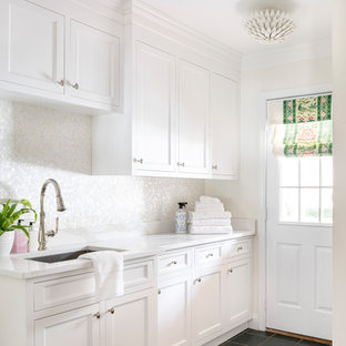 Dedicated laundry room - mid-sized transitional single-wall ceramic tile dedicated laundry room idea in Boston with white cabinets, quartz countertops, mosaic tile backsplash, white walls and white countertops