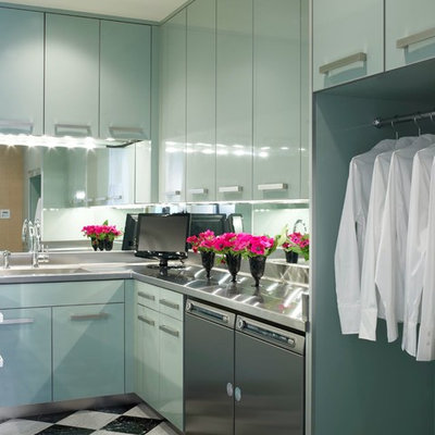 Laundry room - contemporary laundry room idea in Miami with flat-panel cabinets, blue cabinets, a side-by-side washer/dryer and stainless steel countertops