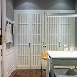 Mid-sized danish single-wall dedicated laundry room photo in Barcelona with white cabinets and recessed-panel cabinets