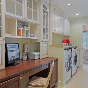 Example of a classic utility room design in DC Metro with raised-panel cabinets and a side-by-side washer/dryer