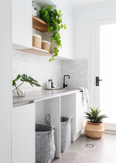 Contemporary Laundry Room by Studio Black Interiors