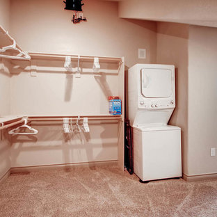 Large modern galley utility room in Denver with open cabinets, beige walls, carpet and a stacked washer and dryer.