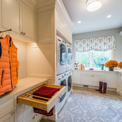 Elegant dedicated laundry room photo in Cleveland with beaded inset cabinets, white cabinets, gray walls and white countertops
