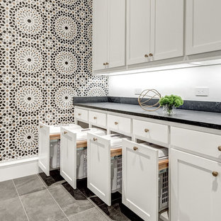 Contemporary galley dedicated laundry room in Dallas with an undermount sink, shaker cabinets, white cabinets, quartz benchtops, multi-coloured walls, ceramic floors, a side-by-side washer and dryer, grey floor and blue benchtop.